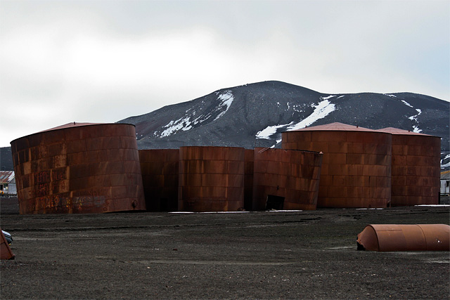 Forty-five men were buried in the station's cemetery, but the cemetery was itself buried in the 1969 eruption, and the only remaining signs are the rusting boilers and tanks.