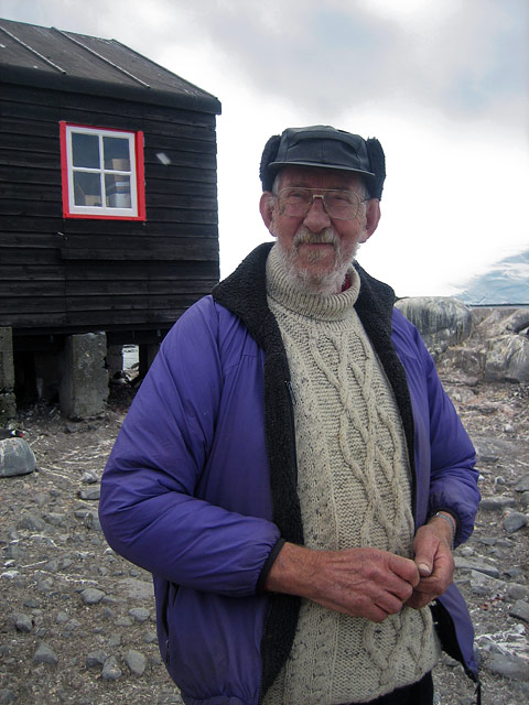 Alan, from Port Lockroy base. He first came to Port Lockroy in 1955. He leads me along the rocky shoreline, and pointing says…