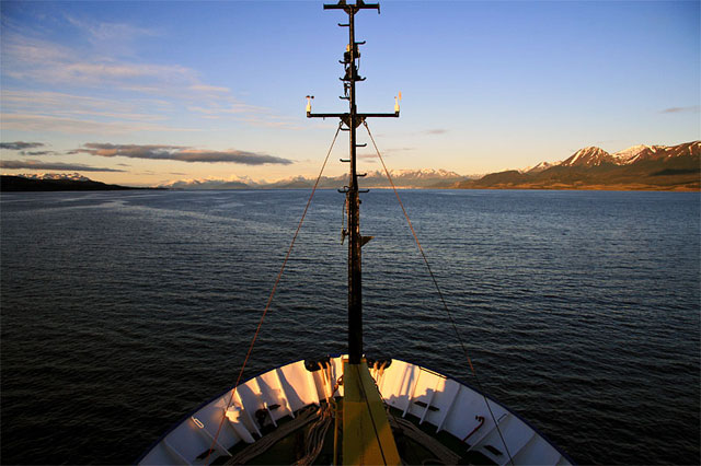 …but then the skies clear and the sun shines down on the blue waters. Sailing the Beagle Channel at dawn.